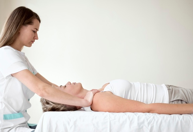 female-patient-undergoing-therapy-with-physiotherapist_23-2148836494